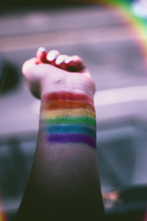 Person With Rainbow Color Paint on His Wrist stock image