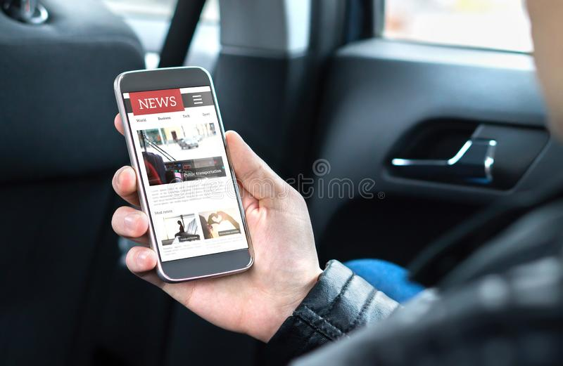 Person reading online news with mobile phone. Newspaper website mockup on smartphone screen. Man enjoying daily press service. Person reading online news with stock photos