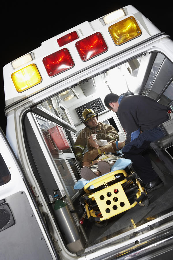 Person Receiving Medical Aid Inside ambulans arkivfoton