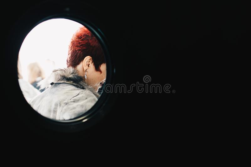 Person With Red Hair Wearing Gray Parka royalty free stock image