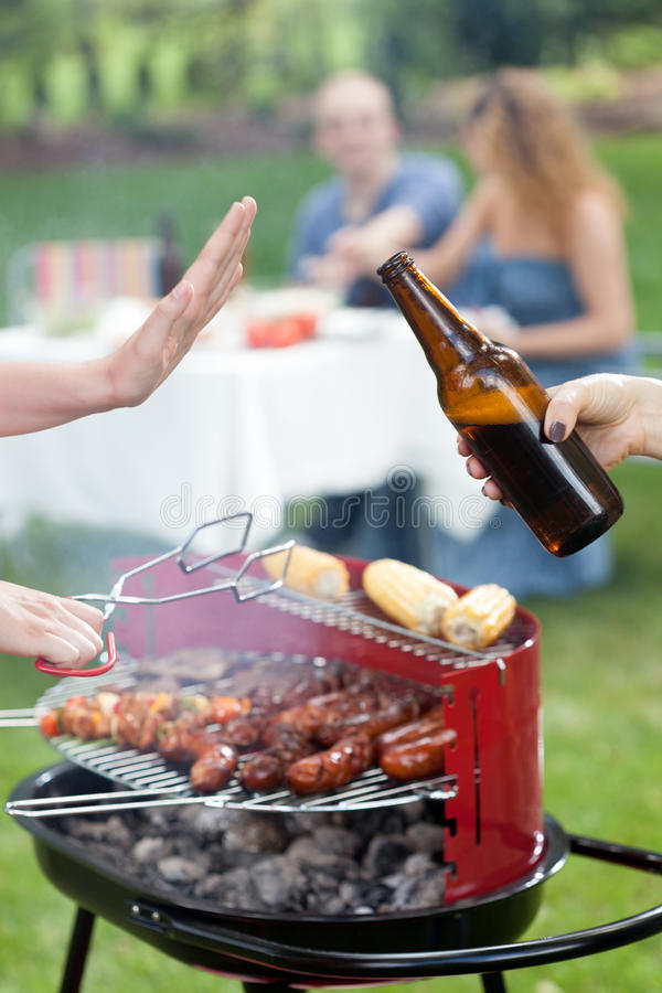 Person refusing beer stock images