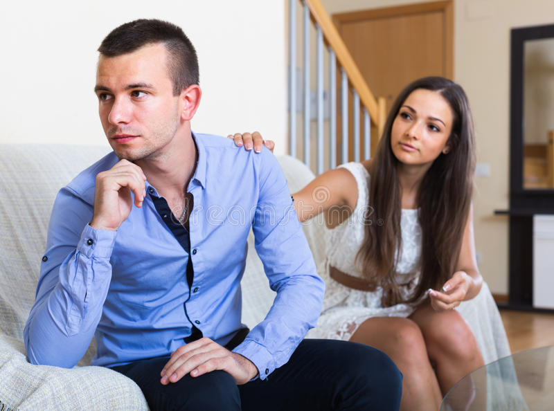 Person rejecting trials of spouse to reconcile. Offended adult american person rejecting trials of spouse to reconcile royalty free stock image