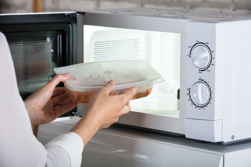 Person Removing Prepared Food fotografering för bildbyråer