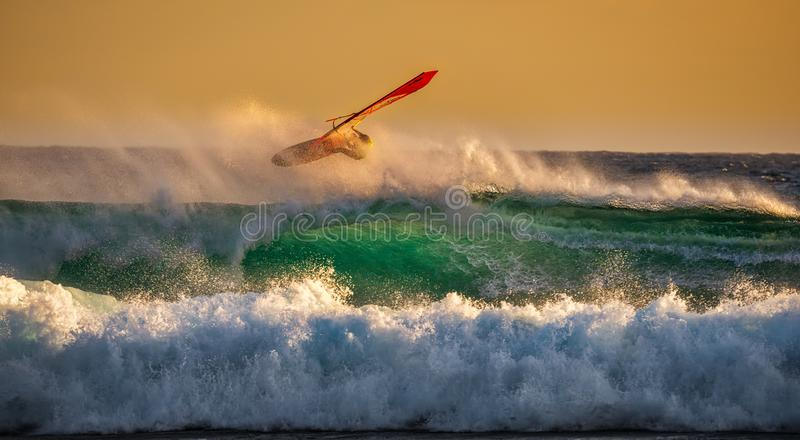 Person Ridding Wind Boat Above Ocean Wave royalty free stock photo