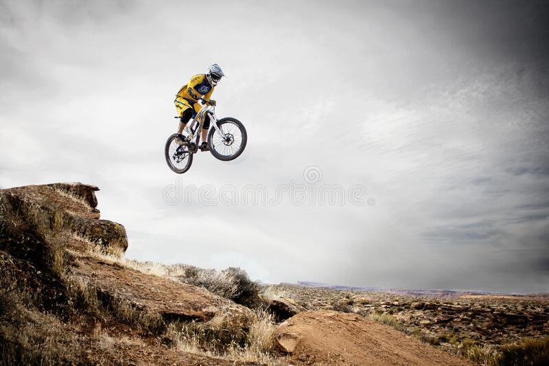 Person Riding Bike Making Trek on Thin Air stock photos