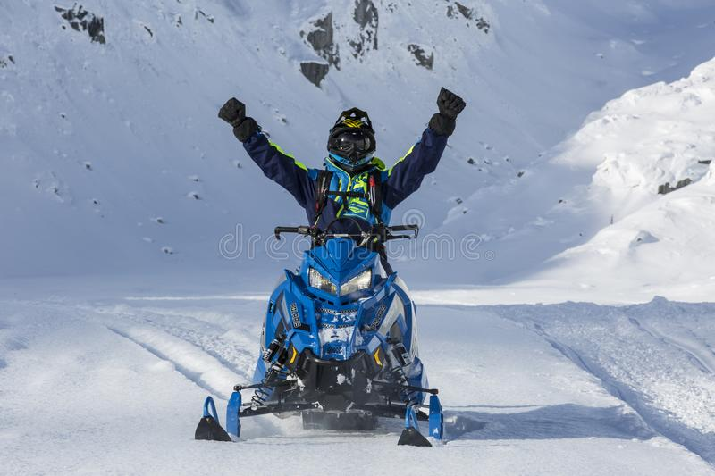 Person Riding Blue Snow Mobile stock images
