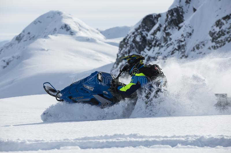 Person Riding on Snowmobile stock photography