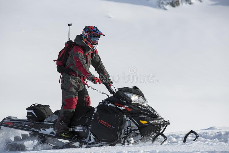 Person Riding on Snowmobile stock images