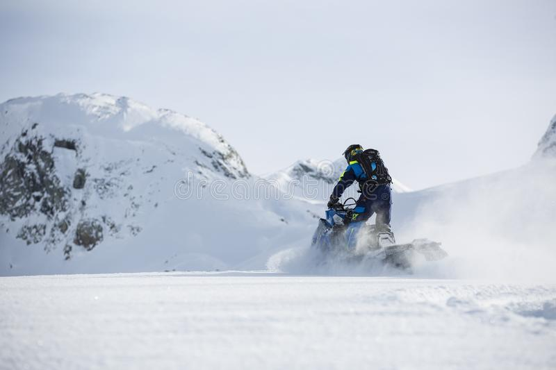 Person Riding on Snowmobile during Winter royalty free stock image