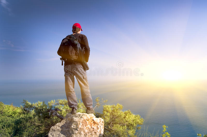 Download The Person On A Rock Looks  At Ocean Stock Photo - Image: 21715178