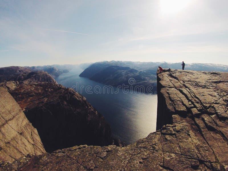 Person on rocky precipice stock photography