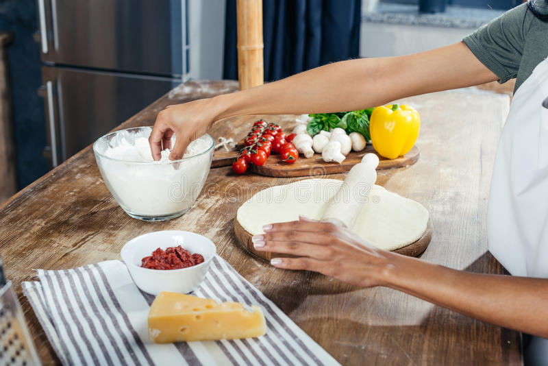 Download Person Rolling Dough While Cooking Pizza Stock Photo - Image of cook, pizza: 98073270