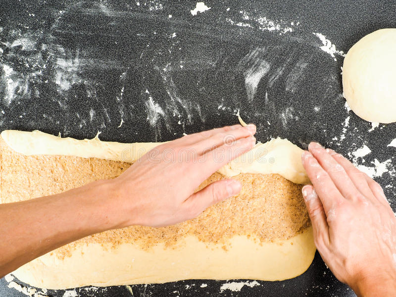 Download Person Rolling A Snail Bun With Spread Stock Photo - Image: 46309860