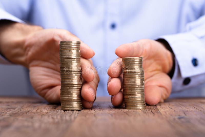 Person`s Hand Holding Stack Of Coins royalty free stock images