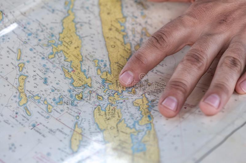 Person's Hand On Yellow Blue And White Map Free Public Domain Cc0 Image