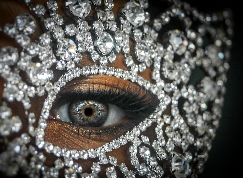 Person's Right Eye With Clear Gemstone Studded Decor stock photo