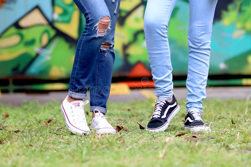 Person's Wearing White and Black Low-top Sneakers stock photos