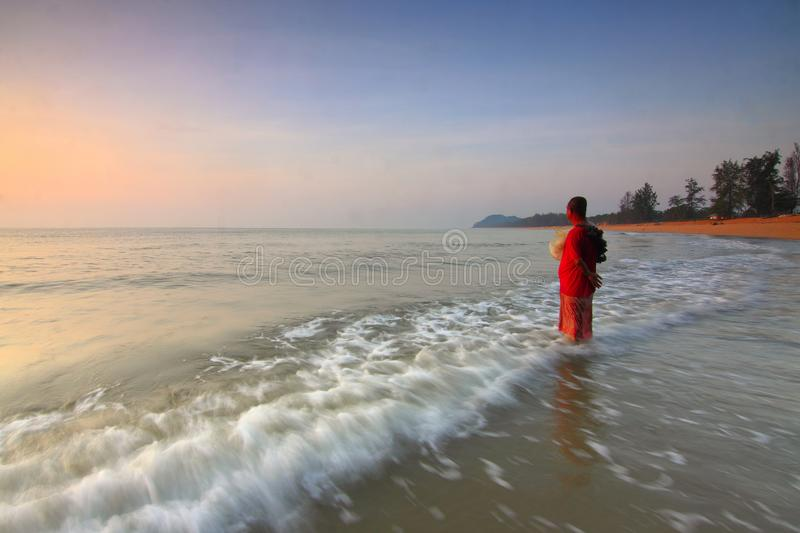 Person on the Seashore during Sun Set stock images