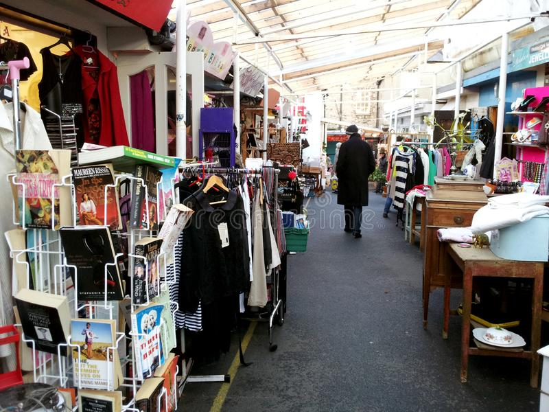 Person in a second-hand outdoors market. Is a typical Imagen about buy stock photo