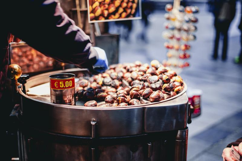 Person Selling Chestnuts stock photos
