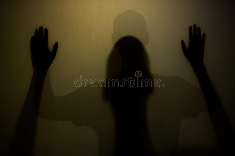 Person shadows. With Frosted glass stock photos