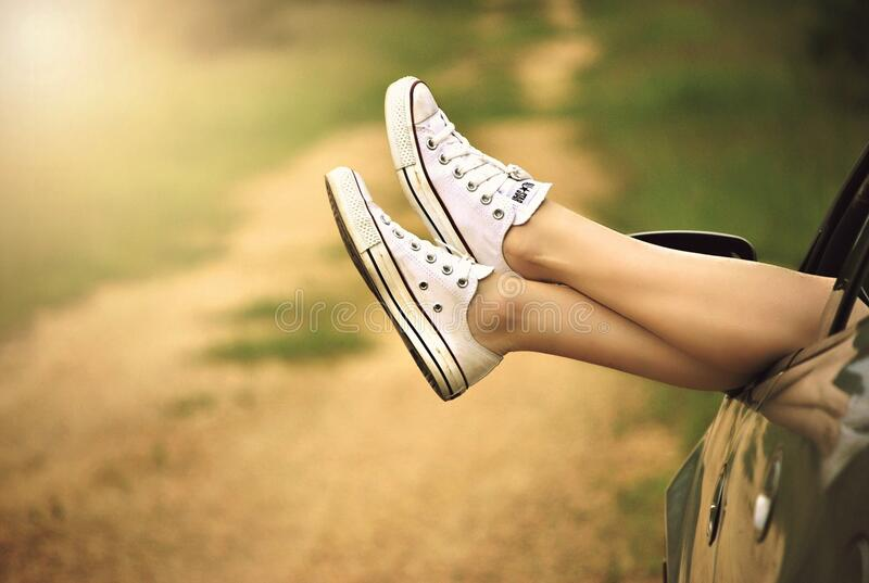 Person Showing Its Feet Wearing White Sneakers Free Public Domain Cc0 Image