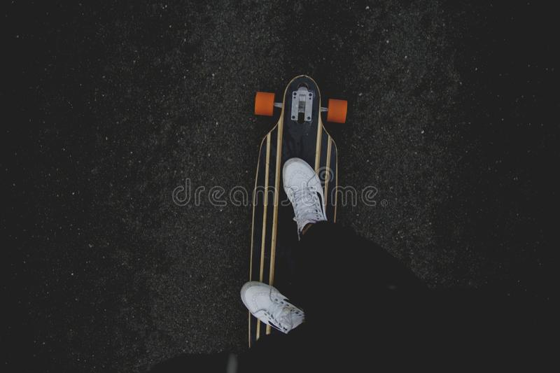 Person Showing White Sneakers And Riding Black Orange And White Skateboard Free Public Domain Cc0 Image