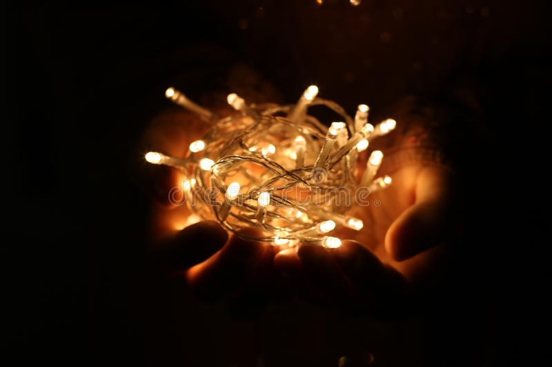 Person Showing White String Lights during Nightime royalty free stock image