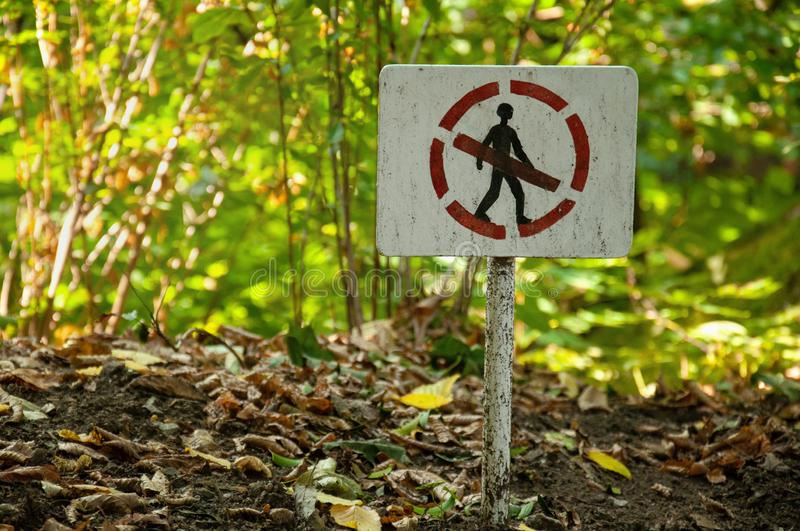 Pointer prohibiting passage in the forest. Prohibition sign in the park. A person sign is prohibited. Pointer prohibiting passage in the forest. Prohibition sign stock photo