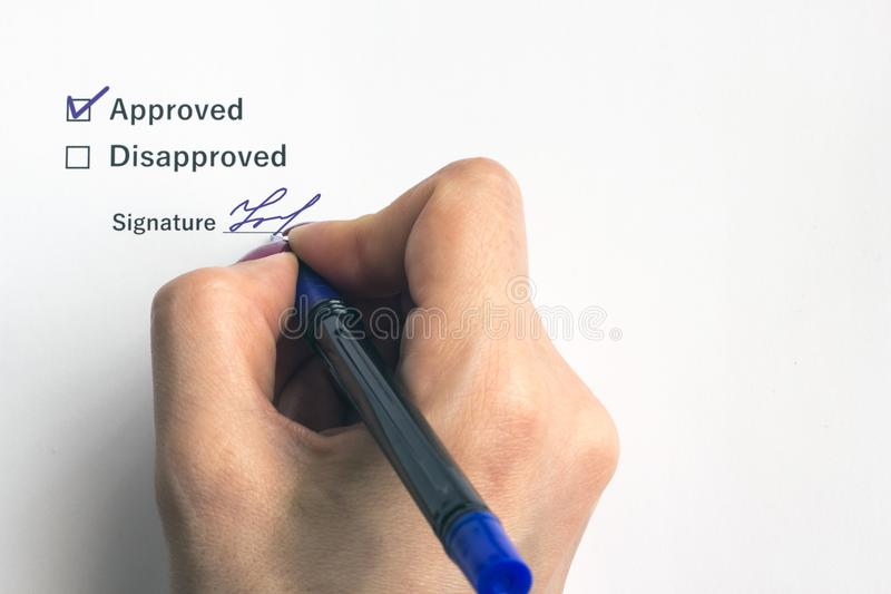 A person signs an important document or decision, close-up stock image