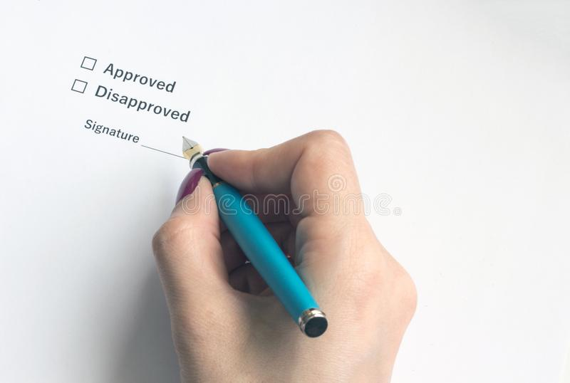 A person signs an important document or decision, close-up royalty free stock photo