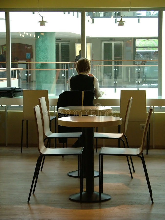 Download Person Sitting In The Cafeteria Stock Photo - Image of chair, dinette: 156988