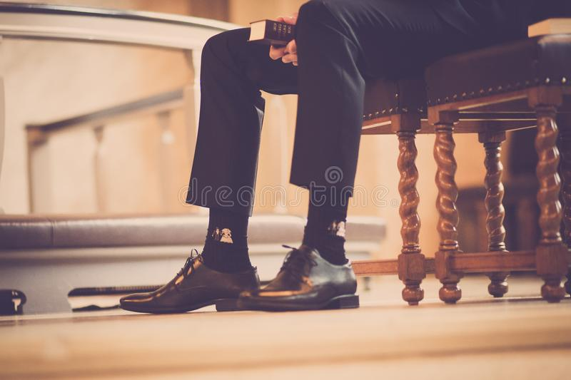 Person Sitting On A Chair Holding Book stock photography