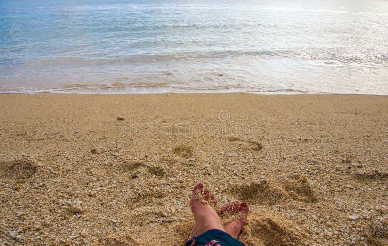 Person Sitting on Seashore stock photo