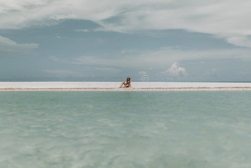 Person Sitting On White Sand stock photos