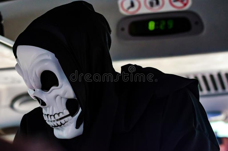 Person in skeleton mask and black hood royalty free stock photos