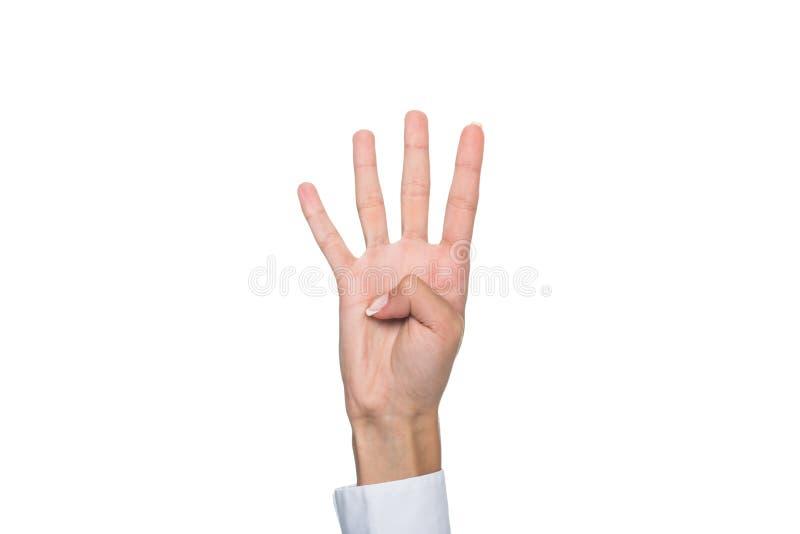 Person som gör en gest undertecknat språk eller visar tecken som fyra isoleras på vit arkivbild