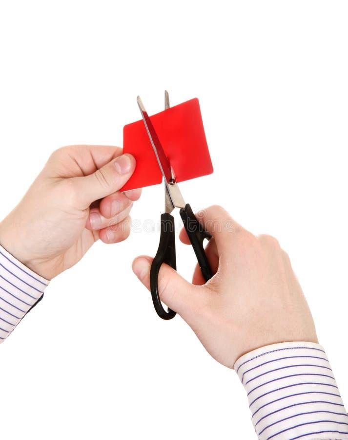 Person som klipper en kreditkort arkivbilder