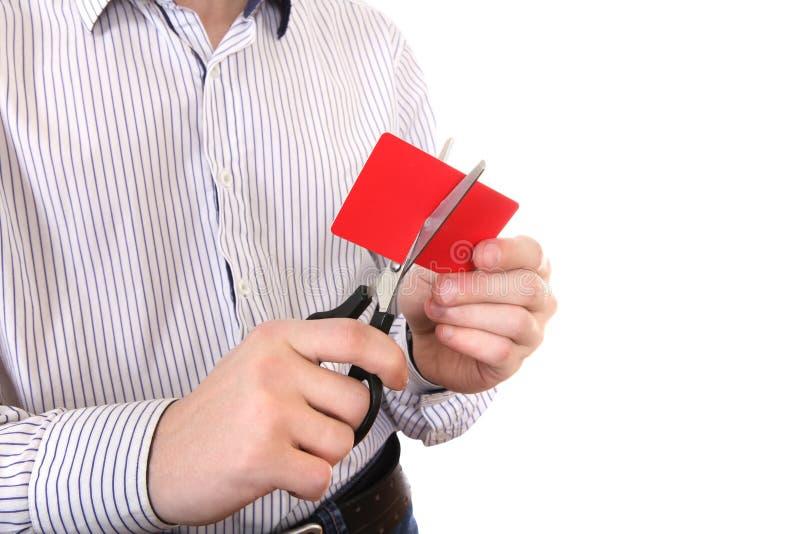 Person som klipper en kreditkort royaltyfri bild