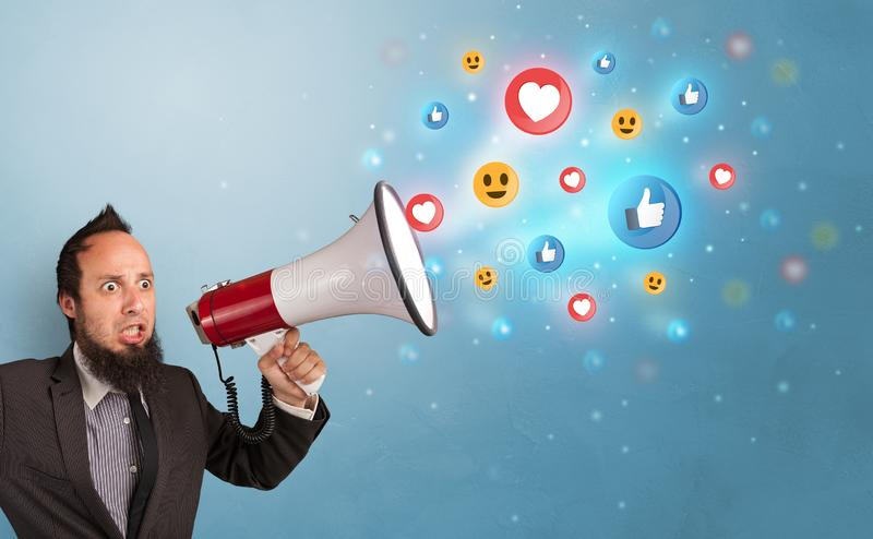 Person speaking in loudspeaker with social media concept royalty free stock image