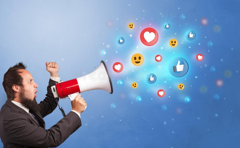 Person speaking in loudspeaker with social media concept stock photography