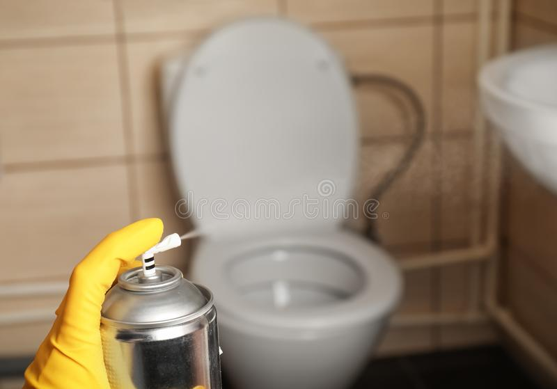 Person spraying air freshener. In bathroom stock images