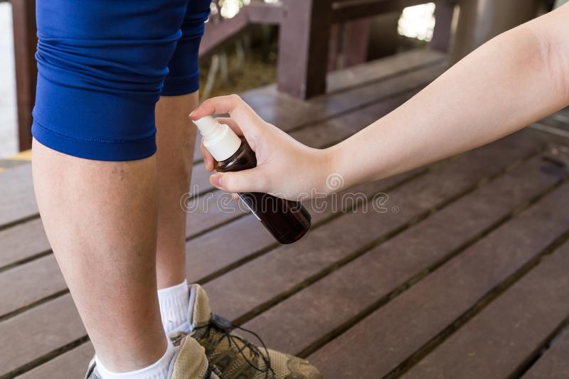Person spraying organic insect repellent before go hiking outdoor. Person spraying organic insect repellent before go hiking into the woods outdoor stock images
