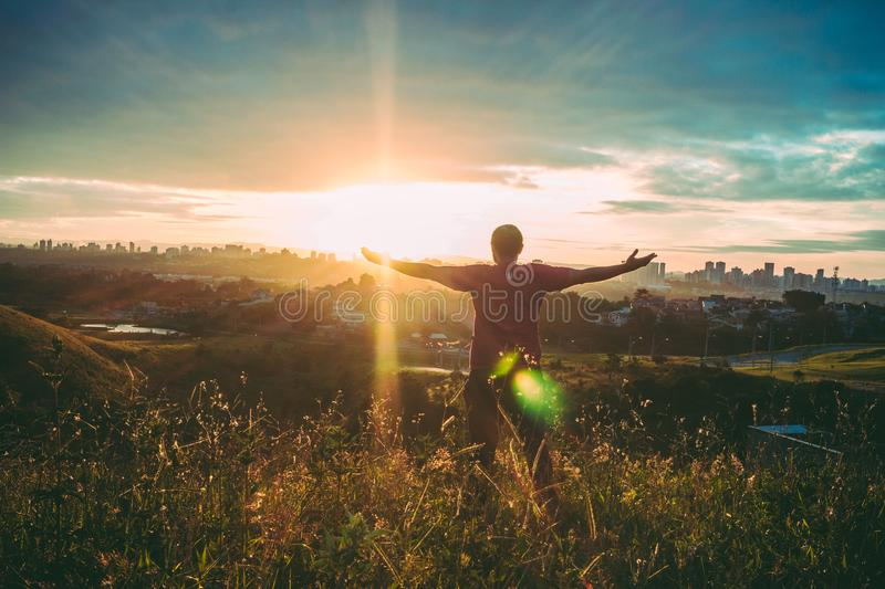 Person Spreading Hands Against Sun stock image
