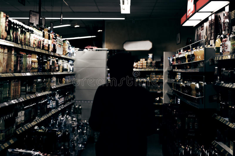 Person Standing Between Display Rack Inside The Room Free Public Domain Cc0 Image