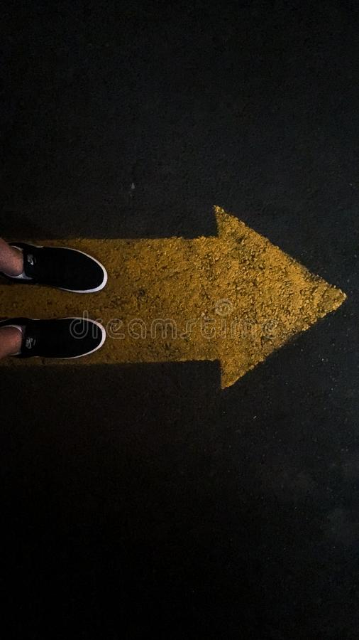 Person standing on an error showing direction royalty free stock images