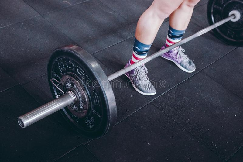 Person Standing Near Black Barbell stock image