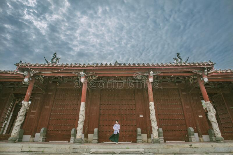 Person Standing Near Red Gate Free Public Domain Cc0 Image