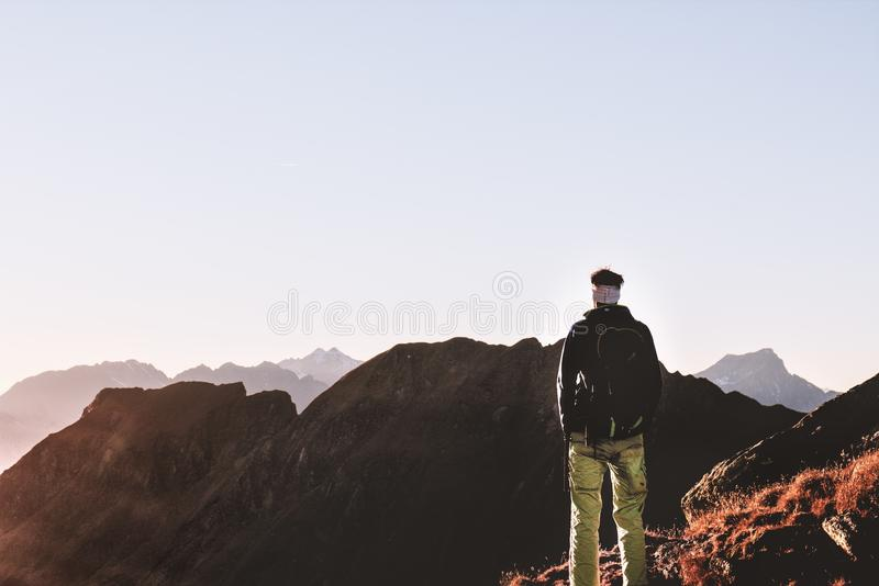 Person Standing on Top of the Mountain royalty free stock images