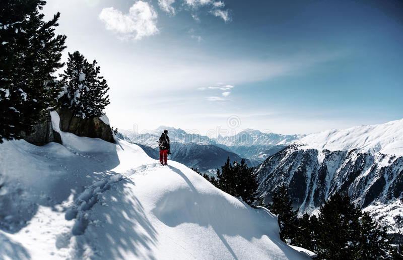 Person Standing On Top Of Snow Covered Mountain During Daytime Free Public Domain Cc0 Image